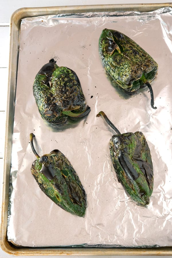 Four roasted poblano peppers