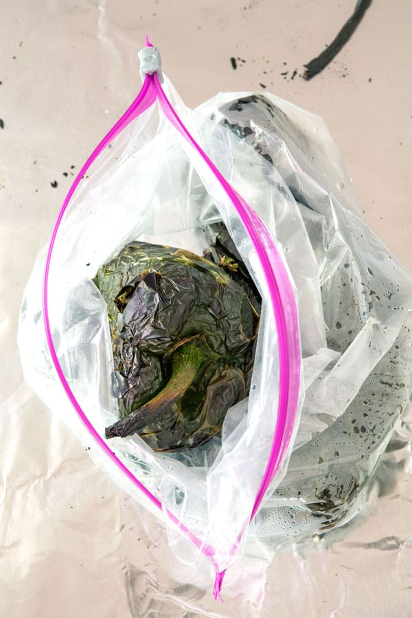 Roasted poblano peppers steaming in ziplock bag