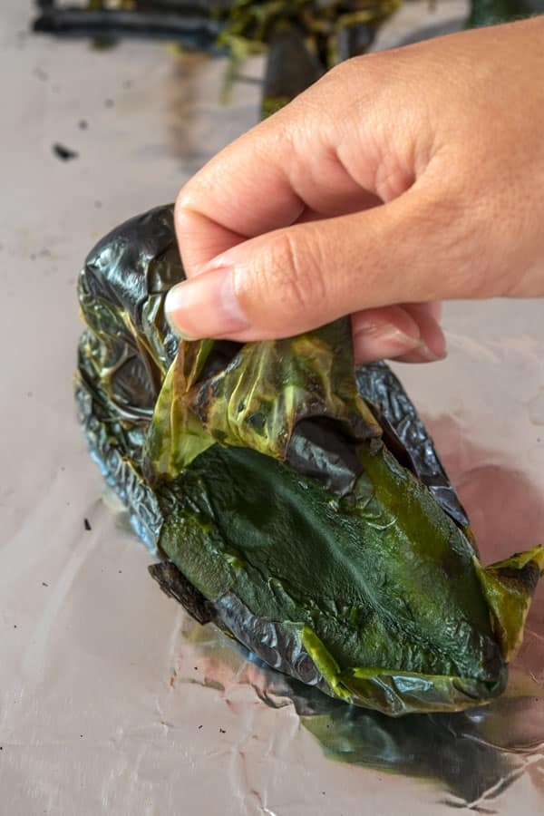 Peeling a roasted poblano pepper