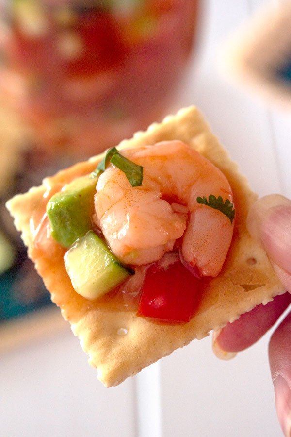 Saltine cracker with Mexican shrimp cocktail on top