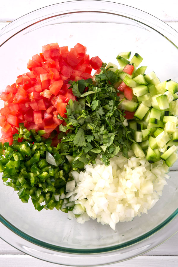 Chopped ingredients for coctel de camarones in a prep bowl